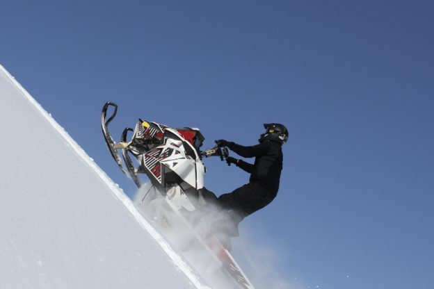 Snowmobiler on incline